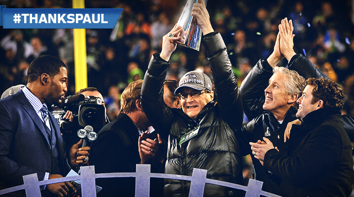 Seahawks owner Paul Allen holds up the Super Bowl trophy