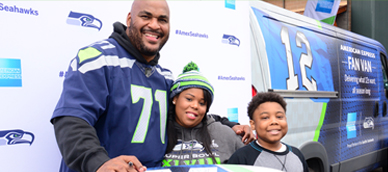 Walter Jones poses for a picture with two young fans