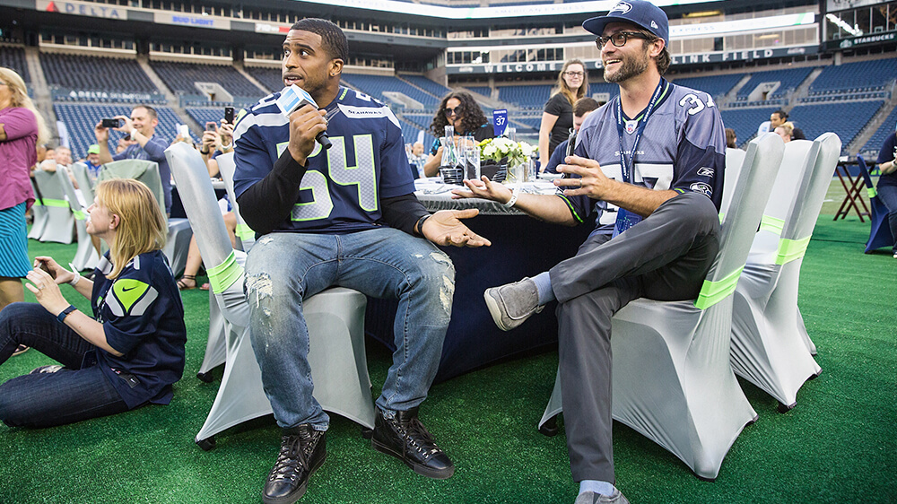 Bobby Wagner sits at the table with fans