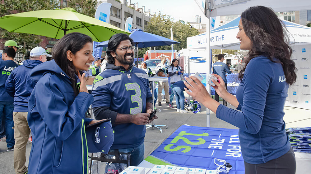 Fans talk with American Express representative