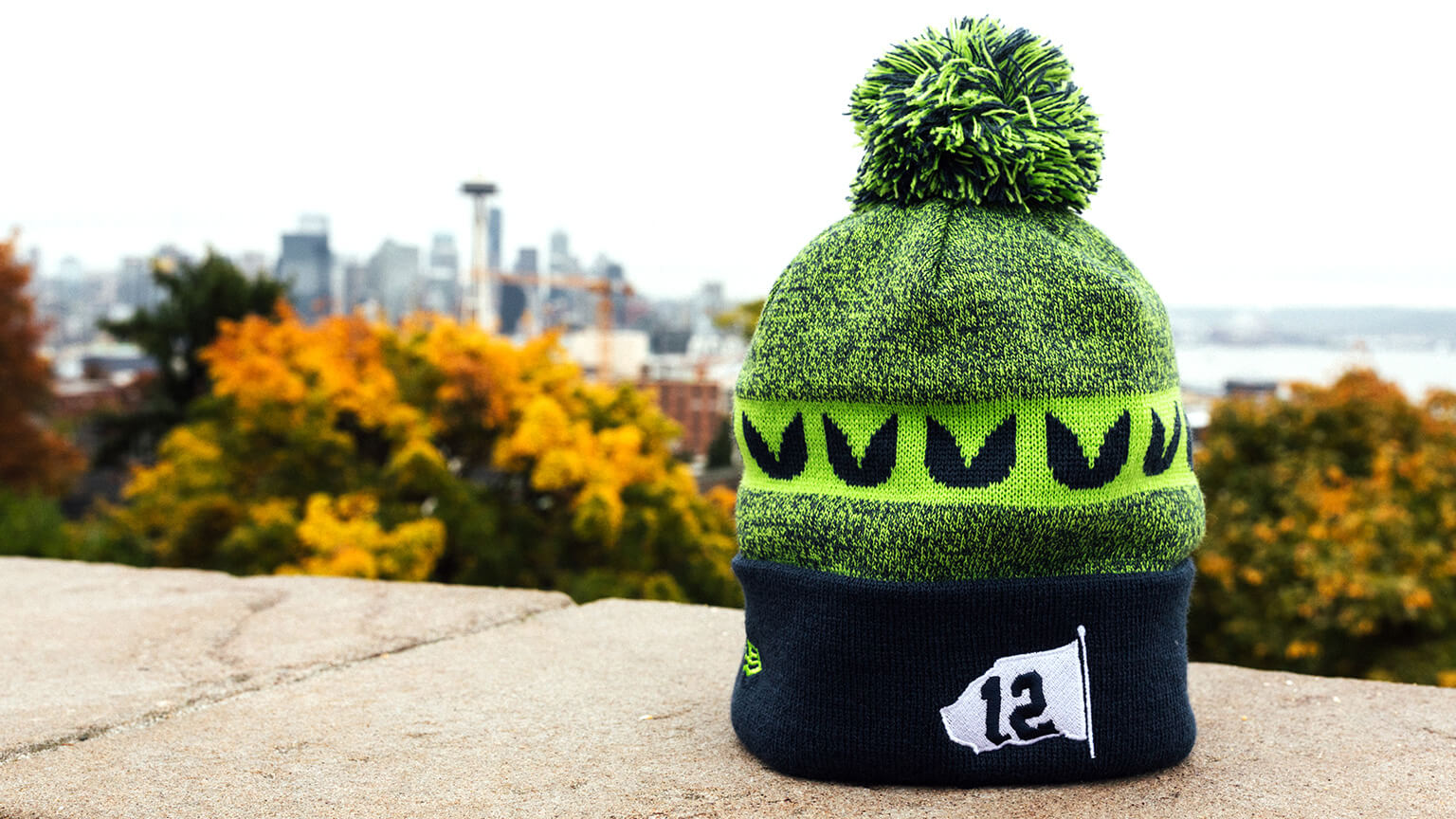 Knit hat with pom on top - 12 flag decal in fold up flap