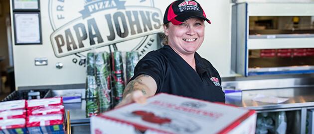 Papa John's vendor handing pizza